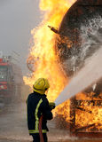 Fire-fighter fighting fire Royalty Free Stock Photography
