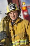 Fire Fighter Holding Hose On Shoulder Stock Photo