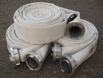 Fire fighter hose on the asphalt background Royalty Free Stock Photo