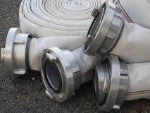Fire fighter hose on the asphalt background. Close up fire fighter hose on the asphalt Stock Photo