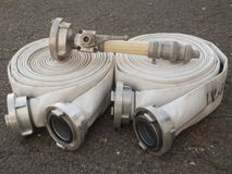 Fire fighter hose on the asphalt background Stock Photos