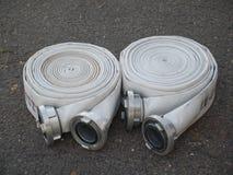 Fire fighter hose on the asphalt background Stock Image