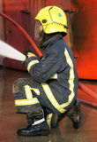 Fire fighter with hose Royalty Free Stock Photos