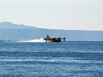 Fire fighter hydroplane on blue sea Stock Images