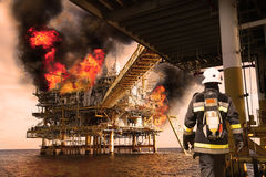Fire fighter on oil and gas industry, successful firefighter at work , Fire suit for fighter with fire and suit for protect fire. Fighter, Security team when royalty free stock images