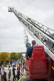 Fire fighter oparating crane Stock Photos