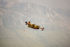 Fire fighter plane over the mountains Royalty Free Stock Images