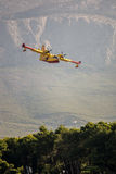 Fire fighter plane over the mountains Stock Photo