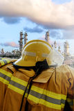 Fire fighter`s uniform. On refinery plant background Stock Photography