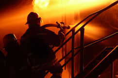 Fire fighter silhouettes 1 Royalty Free Stock Photos