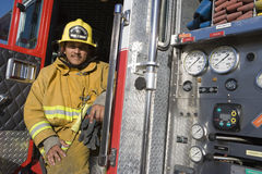 Free Fire Fighter Sitting At Fire Brigade S Door Royalty Free Stock Photography - 29651307