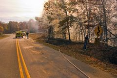 Fire fighters 2. Some fire fighters battling this roadside blaze in the Ozark Mountains stock photography