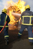 Fire fighters fighting fire Royalty Free Stock Photo