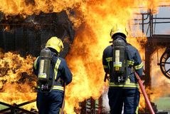 Fire fighters fighting fire Stock Image