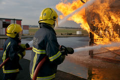 Fire fighters fighting fire Stock Images