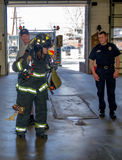Fire fighters getting ready Stock Images