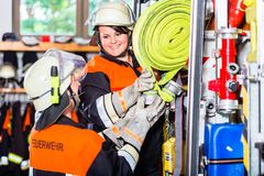 Free Fire Fighters Loading Hoses Into Operations Vehicle Stock Photography - 101501842