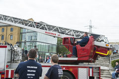 Fire fighters manning crane Royalty Free Stock Photos