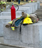 Fire Fighters uniform ready for action. A Firefighters uniform with a Canadian emblem ready and waiting for action at a local demolition derby Royalty Free Stock Images
