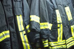 Fire fighters uniform station equipment. Fire station firefighter training equipment protective uniform used by fireman to fight fires and protect from flames Royalty Free Stock Images