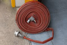 A close up view of a rolled up fire water hose royalty free stock photos