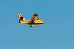 Fire fighting airplane flying Stock Image