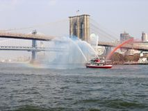 A fire fighting boat in New York city royalty free stock photo