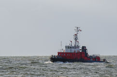 FIRE FIGHTING BOAT. Sails on the open sea. The ship returns to port in Swinoujscie after job protection tanker Stock Photos