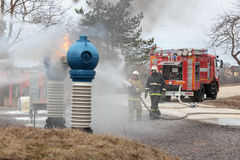 Fire fighting during the emergency training at Narvskaya HPP Royalty Free Stock Photo