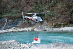 Fire fighting helicopter collecting water Stock Photo