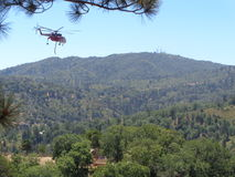 Fire Fighting Helicopter in for Water Refill, Papoose Lake , Lake arrowhead, CA. Helicopter coming in to refill water in Papoose Lake, Lake Arrowhead Area Royalty Free Stock Images