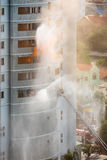 Fire fighting in high rise Stock Photos