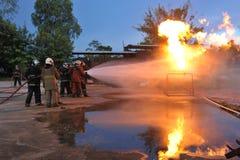 Fire fighting training. Stock Photos