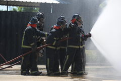 Fire fighting training. Royalty Free Stock Images