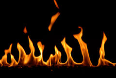 Fire Fire Fire. A wooden bar was burning beyond the dark wall stock photography
