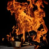 Fire. Flames with a black dark background stock image