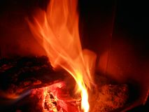 Fire. Flames in motion on dark background Royalty Free Stock Images