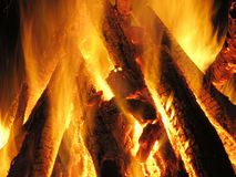 Fire, fire-place, flame,. Conflagrant logs, fire or fire-place in the evening stock photography