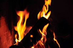 Fire in the fireplace. A fire is burning in the open fireplace royalty free stock images