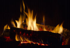 Fire in fireplace. Flames dance in fireplace on burning wood Royalty Free Stock Images