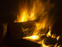 Fire in fireplace. Burning wooden chunks in fireplace Royalty Free Stock Image