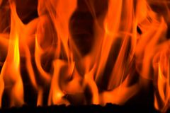 Fire in a fireplace. Flames in a fireplace in anybody house at cold weather Stock Photos