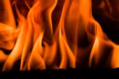 Fire in a fireplace Stock Images
