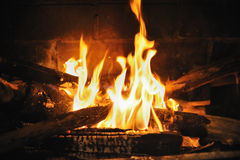 Fire in fireplace. A fire burns in a fireplace Stock Photos