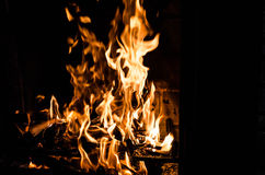 Fire in Fireplace. A blazing wood fire in fireplace in the winter Royalty Free Stock Photos