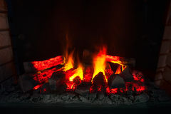 Fire in a fireplace. Burning fire in the fireplace Royalty Free Stock Images