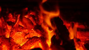Fire in fireplace. Burning fire in fireplace in the middle of winter stock video footage