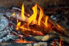 Fire in fireplace. Close up of hot red fire from coal in central heating stove. Stock Photography