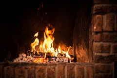 Fire in fireplace. Closeup of firewood burning in fire stock image