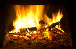 Fire in fireplace. Stock Image